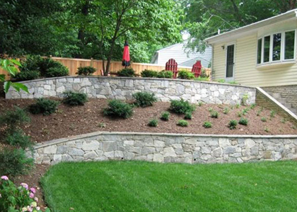 Yard Multi-tiered stone retaining wall