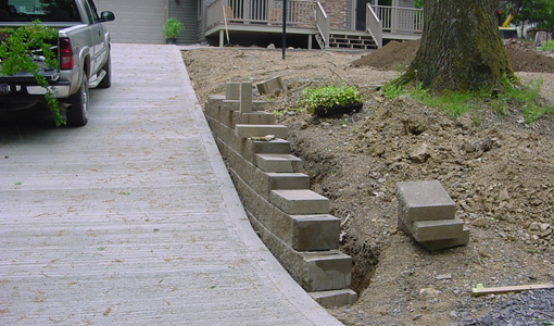 Decorative driveway retaining wall being built