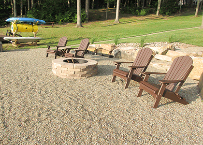 Lake front fire pit with new lawn installation